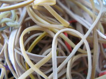 Elastic bands. A closeup of different coloured elastic bands, thrown together in a chunk stock images