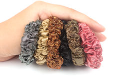 Elastic bands of hair multi-colored on a hand Royalty Free Stock Photo