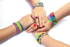 Elastic and colorful rainbow loom bracelet on hands Royalty Free Stock Images