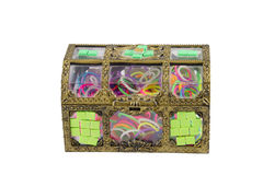 Elastic loom bands color full in side box isolate on white backg. Round Stock Photos