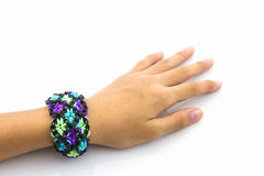 Elastic rainbow loom bands on hand. Royalty Free Stock Images