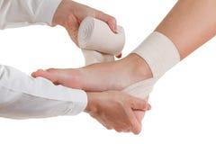 Elastic supportive orthopedic bandage, compression stabilizer ankle, isolated on white. Flexible elastic supportive orthopedic bandage isolated on white royalty free stock images