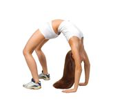 Elastic  woman. Girl in white workout clothes doing some exercise Stock Photos