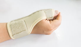 Elastic wrist support. Brace band wrap on hand to relieve pain, selective focus Royalty Free Stock Image