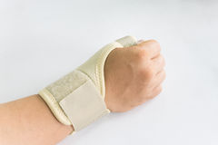 Elastic wrist support. Brace band wrap on hand to relieve pain, selective focus Royalty Free Stock Photography