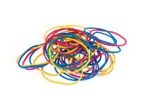 Elastici multicolori sopra un fondo bianco Fotografie Stock