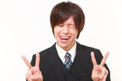 Elated businessman. Concept shot of young Japanese man Royalty Free Stock Photography