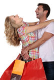 An elated couple embracing Stock Image