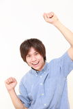 Elated man. Studio shot of young Japanese man on white background Stock Photography