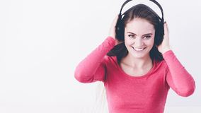 Elated mirthful woman listen music. Stock Images