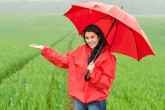 Elated smiling girl during rainy weather. Outside with umbrella Stock Image