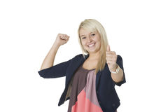 Elated woman giving a thumbs up. Beautiful elated woman giving a victorious thumbs up and punching the air with her fist in jubilation Stock Photos