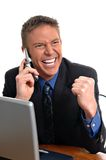Elation. A businessman listenting to thrilling news on the phone Stock Photos