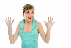 Elation. Young pretty woman raises hands from elation Royalty Free Stock Photography