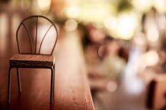 Żelazny krzesło projekt z drewnianym siedzeniem Obraz Stock