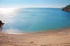 Elba Island. Desert beach and cristal clear sea Stock Photos