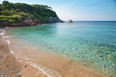 Elba Island. Desert beach and cristal clear water Royalty Free Stock Photo