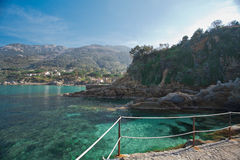 Elba Island. Little path on the cliff and crystal clear water Royalty Free Stock Photography