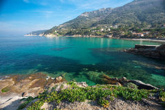 Elba Island. Little path on the cliff and crystal clear water Stock Photo