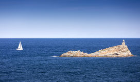 Elba island, Portoferraio Scoglietto little rock and lighthouse. Royalty Free Stock Photography