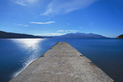 Elba island sea, pier or jetty and Capanne mountain. Tuscany, It Stock Photo