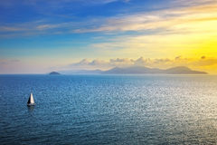 Elba island sunset view from Piombino an sail boat. Mediterranea royalty free stock photography