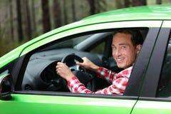 Elbilchaufför - grönt energibiobränslebegrepp Royaltyfria Bilder