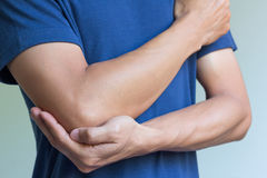 Elbow bone fracture. Male having pain in injured arm Royalty Free Stock Photos