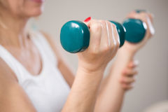 Elbow flexion with dumbbells. Exercise for biceps Stock Photography