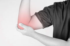 Elbow injury in humans .elbow pain,joint pains people medical, mono tone highlight at elbow.  Stock Photo