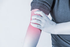 Elbow injury in humans .elbow pain,joint pains people medical, mono tone highlight at elbow Stock Photo