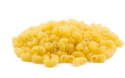 Elbow macaroni. Plenty of elbow macaroni isolated on white background stock photography