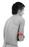 Elbow pain. Young man holding his elbow, having pain Royalty Free Stock Photos
