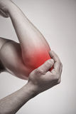 Elbow pain. Injury concept Stock Images