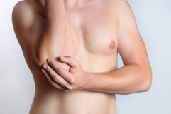 Elbow pain. Acute pain in a man elbow Stock Photography