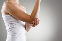 Elbow pain. Elbow bone fracture. Female having pain in injured arm Royalty Free Stock Images