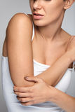 Elbow Pain. Closeup Beautiful Female Body With Pain In Arms Royalty Free Stock Photo