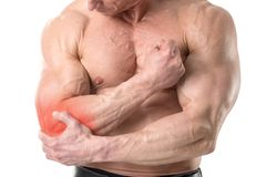 Elbow pain. Closeup of shirtless man with elbow pain isolated in white background Stock Image