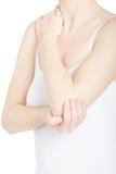 Elbow pain, woman in white shirt holding her arm on white Stock Photos