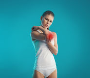 Elbow pain. Young woman having limb trauma indicated with red. Concept of elbow injury, inflammation and pain Stock Images