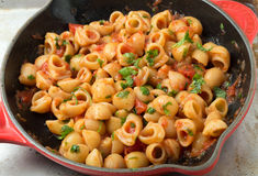 Elbow pasta arrabbiata mixed in a pan Stock Images