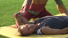 Elbow stretching on mat, Thai massage. stock footage