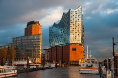 The Elbphilharmonie on the banks of Elbe river royalty free stock photography
