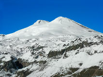 Elbrus. Snow-covered top of Elbrus on a background of the blue sky Royalty Free Stock Photography