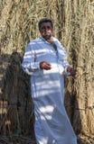 Elbrus lake,Egypt - JULY 24 ,2015:Egyptian man wearing galabia. Elbrus lake,Egypt - JULY 24 ,2015:Unidentified Egyptian man wearing galabia Royalty Free Stock Photography