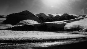 Elbrus region. Dombay. Carachaevo Chercesia. Russian caucasian mountain. Snowboarding. Skiing. Black and white royalty free stock image