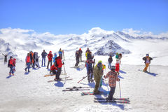 Elbrus. Skiers on the slope of mountain. CAUCASUS, RUSSIA - May 01.2015: Skiers and sportsmen on the slope of mountain Elbrus Stock Photography