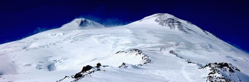 Elbrus - a sleeping volcano. Cone with two peaks Stock Image