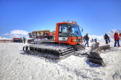 Elbrus. Snow grooming slope of mountain. CAUCASUS, RUSSIA - May 01.2015: Snow grooming at first level on the slope of mountain Elbrus royalty free stock photo