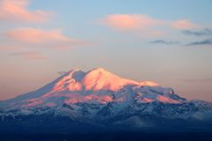 Elbrus at sunset. The snowy peaks of mount Elbrus in sunset stock image